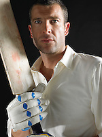 Cricket player holding cricket bat portrait