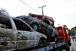 July 25, 2018 - Athens, Greece - Burnt up vehicles seen on top of a tow truck..The aftermath of the destruction by the forest fires in Mati and Neos Voutsas regions of Attiki with more than 80 dead and an unimaginable destruction of property. (Credit Image: © Helen Paroglou/SOPA Images via ZUMA Wire)