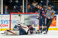 KELOWNA, CANADA - FEBRUARY 23: Kyle Topping #24 of the Kelowna Rockets is checked into the net of Dylan Ferguson #31 by Kyrell Sopotyk #12 of the Kamloops Blazers on February 23, 2019 at Prospera Place in Kelowna, British Columbia, Canada.  (Photo by Marissa Baecker/Shoot the Breeze)