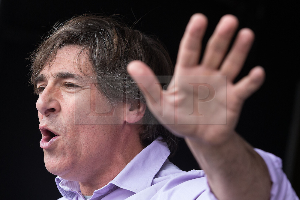 © Licensed to London News Pictures . 20/06/2015 . London , UK . MARK STEEL speaks in Parliament Square . Tens of thousands of people march from the Bank of England to Parliament , to protest economic austerity in Britain . Photo credit: Joel Goodman/LNP