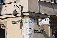 Street signs for Ulica Szczepanska and Slawkowska plus a chemist in Krakow in Poland
