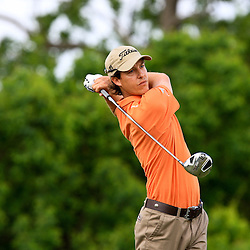 2009 April 26: Chris Riley of San Diego, CA tee's off on the eighth hole during the final round of the Zurich Classic of New Orleans PGA Tour golf tournament played at TPC Louisiana in Avondale, Louisiana.