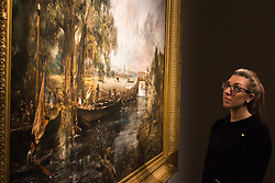"Christie's, St James, London. A woman examines the details of the painting as Christie's in London announce the sale of a work of genius by John Constable, the full scale six-foot ""sketch"" for ""View on the Stour near Dedham"" painted between 1821 and 1822, which is expected to fetch between £18-22 million at auction."