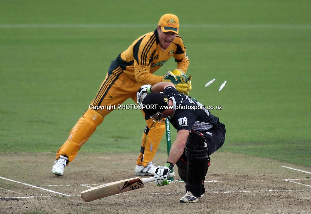 Brad Haddin attempts to run out Gareth Hopkins.<br />3rd one day international. New Zealand Black Caps versus Australia one day Chappell Hadlee cricket series. Seddon Park, Hamilton, New Zealand. Tuesday 9 March 2010. Photo: Andrew Cornaga/PHOTOSPORT