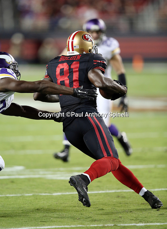 San Francisco 49ers wide receiver Anquan Boldin (81) is chased by Minnesota Vikings cornerback Xavier Rhodes (29) after catching a pass during the 2015 NFL week 1 regular season football game against the Minnesota Vikings on Monday, Sept. 14, 2015 in Santa Clara, Calif. The 49ers won the game 20-3. (©Paul Anthony Spinelli)