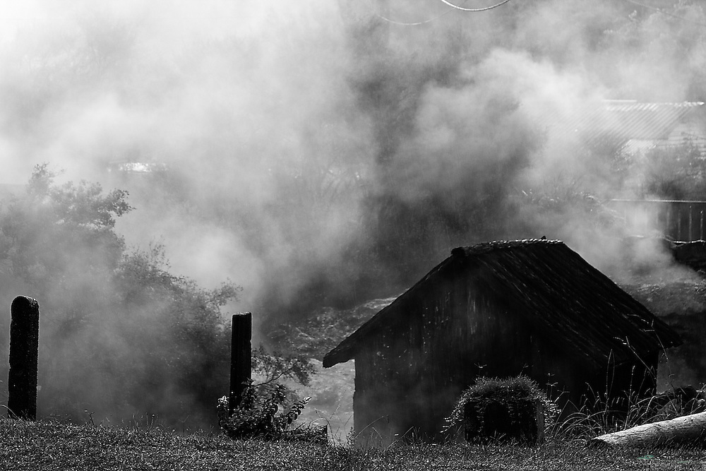 Hut surrounded by steam