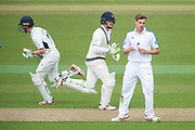 Brad Wheal of Hampshire concedes a run as Nick Gubbings and Sam Robson cross during the Specsavers County Champ Div 1 match between Hampshire County Cricket Club and Middlesex County Cricket Club at the Ageas Bowl, Southampton, United Kingdom on 14 April 2017. Photo by David Vokes.