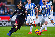 Henrikh Mkhitaryan of Arsenal (7) tries to escape Aaron Mooy of Huddersfield Town (10) during the Premier League match between Huddersfield Town and Arsenal at the John Smiths Stadium, Huddersfield, England on 9 February 2019.