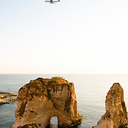 BEIRUT,LEBANON- MAY 2009 :Airplane flying over the  Pigeon Rocks, one of the main  tourist attraction of  Beirut, Lebanon.05/30/2009 ( Photo by Jordi Cami )