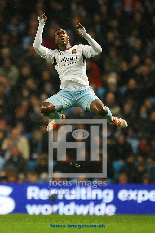 Picture by Paul Chesterton/Focus Images Ltd +44 7904 640267<br /> 08/01/2014<br /> Modibo Maiga of West Ham jumps high for the ball during the Capital One Cup Semi Final 1st Leg match at the Etihad Stadium, Manchester.
