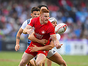 Canadian player Connor Braid off loads the ball in the game Canada vs France during the Cathay Pacific/HSBC Hong Kong Sevens festival at the Hong Kong Stadium, So Kon Po, Hong Kong. on 8/04/2018. Picture by Ian  Muir.