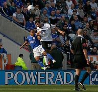 Photo: Steve Bond.<br />Leicester City v Derby County. Coca Cola Championship. 06/04/2007. Levi Porter (L) and Tyrone Mears (R) contest an areiel ball