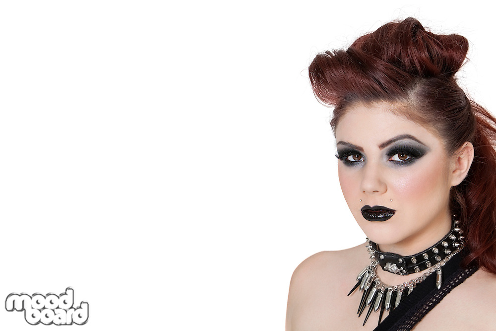 Close-up portrait of a punk woman over white background