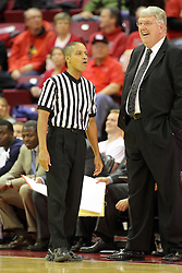 16 November 2014:  Referee Verne Harris chats with Stew Morrill during an NCAA non-conference game between the Utah State Aggies and the Illinois State Redbirds.  The Aggies win the competition 60-55 at Redbird Arena in Normal Illinois.
