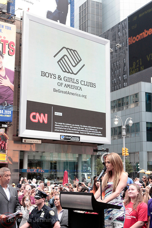 10 June 2010- New York, NY- Jennifer Lopez at The Boys and Girls Clubs of America's (BGCA)' Be Great ' Youth Advocacy Campaign unveling new billboard featuring her childhood picture and inspirational message ' Be Extraordinary ' held at Duffy Square on June 10, 2010 in New York City.