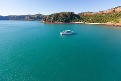 Charter boat MV Odyssey sits off Naturalist Island on the Kimberley coast.