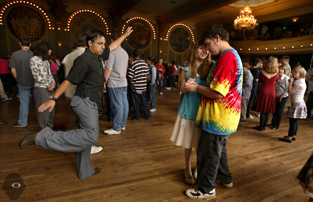 Jeremy Pray, 16, and Annie Maybee, 15, both of Wilsonville, slow dance as another student does his own thing during the 18th-annual special needs prom called Earthstock at the Crystal Ballroom. About 650 high school kids from around the Portland metro area attend this year. ..