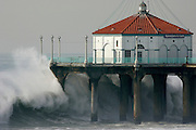 A large wave crashes into the Manhattan Beach pier in Manhattan Beach, CA on December 21, 2005. The pier was shut down due to the 20+ foot tall surf, which is expected through the weekend. REUTERS/Max Morse