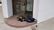 Gerrit, a homeless man, sleeps in front of a door of a downtown hotel during the covid-19 pandemic in March 2020 in  Windsor, Ontario.