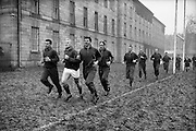 The South African team brave the frozen conditions at College Park to get their early practice in Dublin,..Irish Rugby Football Union, Ireland v South Africa, Tour Match, South African team practice, College Park, Dublin, Ireland, Thursday 15th December, 1960,.15.12.1960, 12.15.1960,..South African Team, ..L G Wilson, Wearing number 15 South African jersey, Full Back, Western Province Rugby Football Club, Cape Town, South Africa, ..AN Other, Wearing number 13 South African jersey, Left Wing, ..A I Kirkpatrick, Wearing number 12 South African jersey, Left Centre, Orange Free State Rugby Football Club, Bloemfontein, South Africa, ..J L Gainsford, Wearing number 11 South African jersey, Right Centre, Western Province Rugby Football Club, Cape Town, South Africa, ..J P Engelbrecht, Wearing number 14 South African jersey, Right Wing, Western Province Rugby Football Club, Cape Town, South Africa,..K Oxlee, Wearing number 10 South African jersey, Stand Off, Natal Rugby Football Club, Durban, South Africa,..R J Lockyear, Wearing number 9 South African jersey, Scrum Half, Griqualand West Rugby Football Club, Kimberley, South Africa, ..S P Kuhn, Wearing number 1 South African jersey, Loose Head Prop, Transvaal Rugby Football Club,  Johannesburg, South Africa,..R A Hill, Wearing number 2 South African jersey, Hooker, Rhodesia Rugby Football Club, Rhodesia, Zimbabwe,..P S du Toit, Wearing number 3 South African jersey, Tight Head Prop, Boland Rugby Football Club, Wellington, South Africa, ..A S Malan, Wearing number 4 South African jersey, Captain of the South African team, Lock, Transvaal Rugby Football Club,  Johannesburg, South Africa,..J T Claassen, Wearing number 5 South African jersey, Lock, West Transvaal Rugby Football Club,  Johannesburg, South Africa,..G H Van ZYL, Wearing number 6 South African jersey, Flank, Western Province Rugby Football Club, Cape Town, South Africa, ..H J M Pelser, Wearing number 7 South African jersey, Number 8, Transvaal Rugby Football Club,