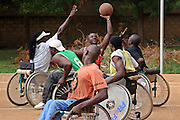 Competition is fierce during the basketball training session in Burkina Faso. It's a very quick game and players are often thrown from their wheelchairs. This group is part of a project set up by Handicap Solidaire who are an NGO for disabled people.
