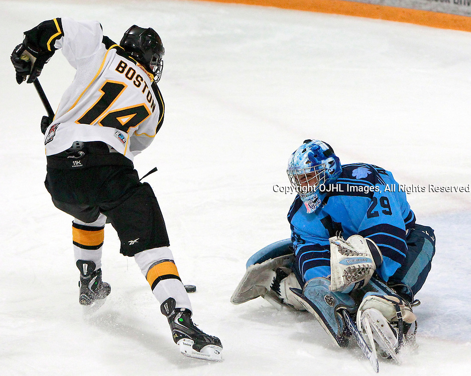 AURORA, ON - Jan 18 : Ontario Junior Hockey League Game Action between the St. Michael's Buzzers and the Aurora Tigers, Tyler Boston #14 of the Aurora Tigers Hockey Club gets past George Argiropoulos #29 of the St.Michael's Buzzers Hockey Club during first period game action.<br /> (Photo by Brian Watts / OJHL Images)