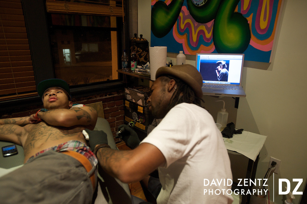 "Rapper Tyga, aka Michael Stevenson, gets a Michael Jackson tattoo at the Sea of Ink tattoo shop in Venice, Calif., on Tuesday, July 7, 2009. The tattoo was based on an iconic profile shot of Jackson performing on stage, hat tipped down over his eyes. ""That's about all we knew about him,"" Tyga said of the image."