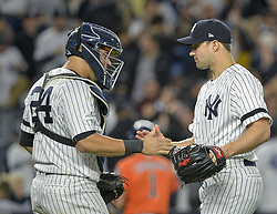 October 18, 2017 - Bronx, NY, USA - New York Yankees relief pitcher Tommy Kahnle, right, shakes hands with catcher Gary Sanchez after the final out in a 5-0 win against the Houston Astros during Game 5 of the American League Championship Series at Yankee Stadium in New York on Wednesday, Oct. 18, 2017. The Yankees' win gives them a 3-2 series lead. (Credit Image: © Howard Simmons/TNS via ZUMA Wire)