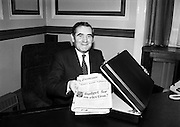 About to put an end to all the speculation: Minister for Finance Gene Fitzgerald TD puts his copy of the Examiner into his budget bag at the Department of Finance, before going to the Dáil.<br /> 28 January 1981