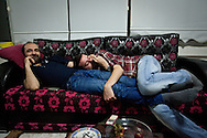 Aref (left) and his partner Umut (right) relax on the sofa in a friends home. Aref is one of the leading members of Hebun LGBT, an association fighting for equality in Diyarbakir across Turkey. Most members are Kurdish and face double discrimination in Turkey for being Kurdish and LGBT. Umut is a poet and active member of Hebun LGBT.