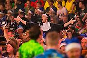 Dart fan in nun fancy dress during the World Darts Championship at Alexandra Palace, London, United Kingdom on 27 December 2015. Photo by Shane Healey.