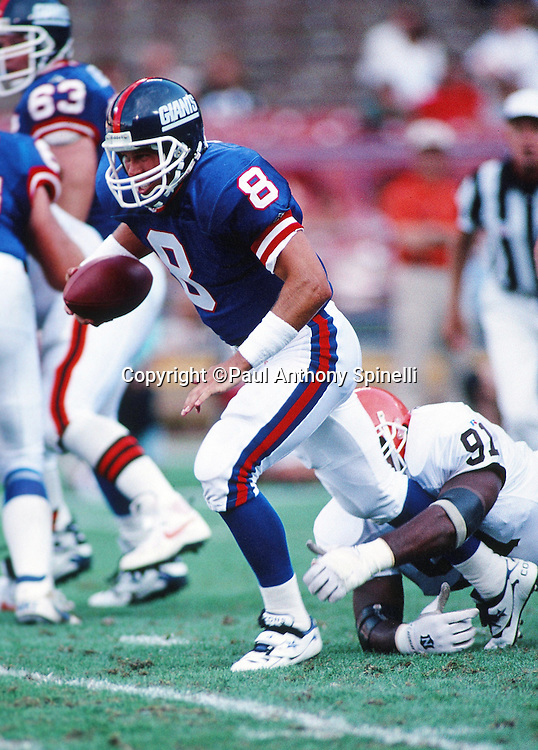 New York Giants quarterback Tommy Maddox (89) tries to break a tackle as he runs the ball during the NFL preseason football game against the Cleveland Browns on Aug. 6, 1995 in Cleveland. The Giants won the game 19-13. (©Paul Anthony Spinelli)