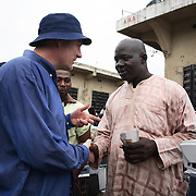 Electronic waste export to Nigeria...Alaba International Market, one of the largest markets for electronic goods in West Africa.  New and old - and a lot of non-working electronic goods such as TVs and computers come in to the market via Lagos harbour from the US, Western Europe and China...Eric Albertsen has bought the TV for N15.000..The shipment - TV-set originally delivered to municipality-run collecting point in UK for discarded electronic products - was tracked and monitored by Greenpeace using a combination of GPS (Global Positioning System using satellites), GSM (positioning using data from mobile networks to triangulate approximate positions) and an onboard radiofrequency transmitter (used for making triangulations in combination with handheld directional receivers used by team on ground) is placed inside the TV-set.  The TV arrived in Lagos in container no 4629416.