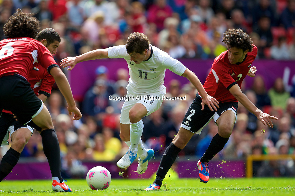 29.07.2012 Manchester, England. New Zealand midfielder Marco Rojas and Egypt defender Mahmoud Alaa El-Din in action during the first round group C mens match between Egypt and New Zealand.