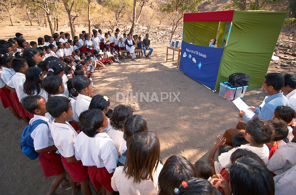 Kids are entranced by RARE Conservation puppet show, Komodo Village, Komodo National Park