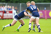 Bradford Bulls loose forward Damian Sironen (10) is stopped by Swinton Lions Ben Austin (18)  during the Kingstone Press Championship match between Swinton Lions and Bradford Bulls at the Willows, Salford, United Kingdom on 20 August 2017. Photo by Simon Davies.