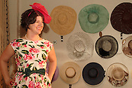 Model Meg Thomas wears a floral dress inspired by the 1950s and Florida's historic shop the Candy Kitchen during the Derby Fashion Extravaganza at Brim, in Dayton's Historic Oregon District, Friday, March 1, 2013.  Dresses for the show were all made by Tracy McElfresh of Sew Dayton.