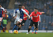 Blackburn Rovers midfielder, Hope Akpan (21) and Brighton central midfielder, Beram Kayal (7) during the Sky Bet Championship match between Blackburn Rovers and Brighton and Hove Albion at Ewood Park, Blackburn, England on 16 January 2016.