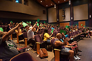Audience members vote on the subject of a video's innocence during the Trial by Jury: A Case of Deportation as a part of the Challenging Dialogues lecture series in Baker Theater September 12. Photo by Hannah Ruhoff