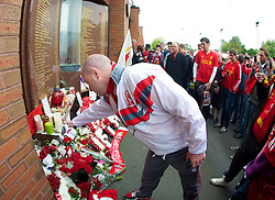 23.09.2012, Anfield, Liverpool, ENG, Premier League, FC Liverpool vs Manchester United, 5. Runde, im Bild A fan touches the Eternal Flame Memorial at Liverpool FC's Hillsborough memorial before The release of the Hillsborough Independent Panel's report shed light on one of the biggest cover-up's in British history which sought to deflect blame from the Police onto the Liverpool supporters during the English Premier League 5th round match between Liverpool FC and Manchester United at Anfield, Liverpool, Great Britain on 2012/09/23. EXPA Pictures © 2012, PhotoCredit: EXPA/ Propagandaphoto/ David Rawcliff..***** ATTENTION - OUT OF ENG, GBR, UK *****