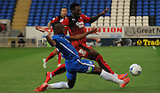 Gabriel Zakuani challenging Roarie Deacon during the Capital One Cup match between Peterborough United and Crawley Town at London Road, Peterborough, England on 11 August 2015. Photo by Michael Hulf.