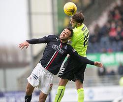 Falkirk's Tom Taiwo and Hibernian's Andrew Shinnie. Falkirk 1 v 2 Hibernian, Scottish Championship game played 31/12/2016 at The Falkirk Stadium .