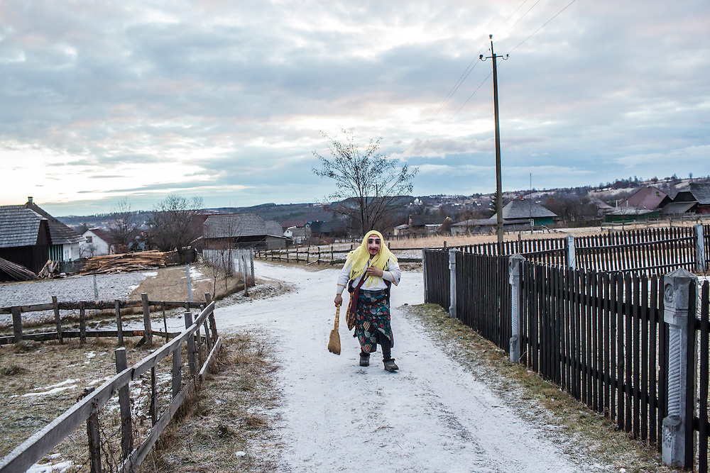 Dmytro Katan, 25, wearing the costume of an old woman, celebrates the Malanka Festival on Thursday, January 14, 2016 in Krasnoilsk, Ukraine. The annual celebrations, which consist of costumed villagers going in a group from house to house singing, playing music, and performing skits, began the previous sundown, went all night, and will last until evening. According to tradition, married men may only participate in Malanka while wearing a mask.