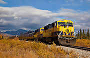 Alaska. Scenic autumn view of the Alaska Railroad traveling south through Broad Pass, south of Cantwell.