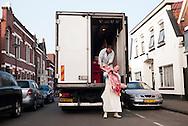 The Netherlands, Nederland, enschede, 24mrt2015 Slager Nijboer van SlagerijNijboer aan de lipperkerkstraat in Enschede laadt een half varken uit bestemd voor zijn winkel.
