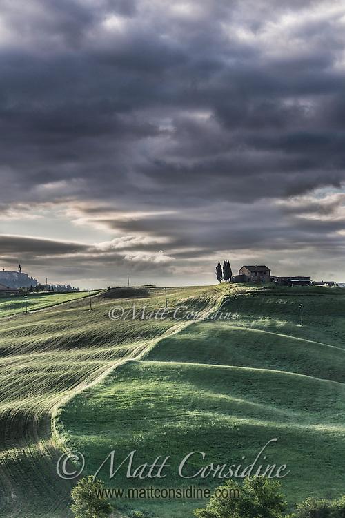 Hilltop villa and fields in afternoon light. (Photo by Travel Photographer Matt Considine)