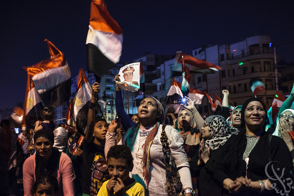 Egyptian supporters of the military's removal of ex-President Mohamed Morsi celebrate waving flags and photos of Egyptian military head General Abdel-Fattah el-Sissi outside the Ittihadiya Presidential palace Friday, July 19, 2013 in the Heliopolis district of Cairo, Egypt. Friday was a day for both supporters and opponents to gather in various locations across Egypt to express their opinions of the recent military decision to remove Mohamed Mosi from power in early July.