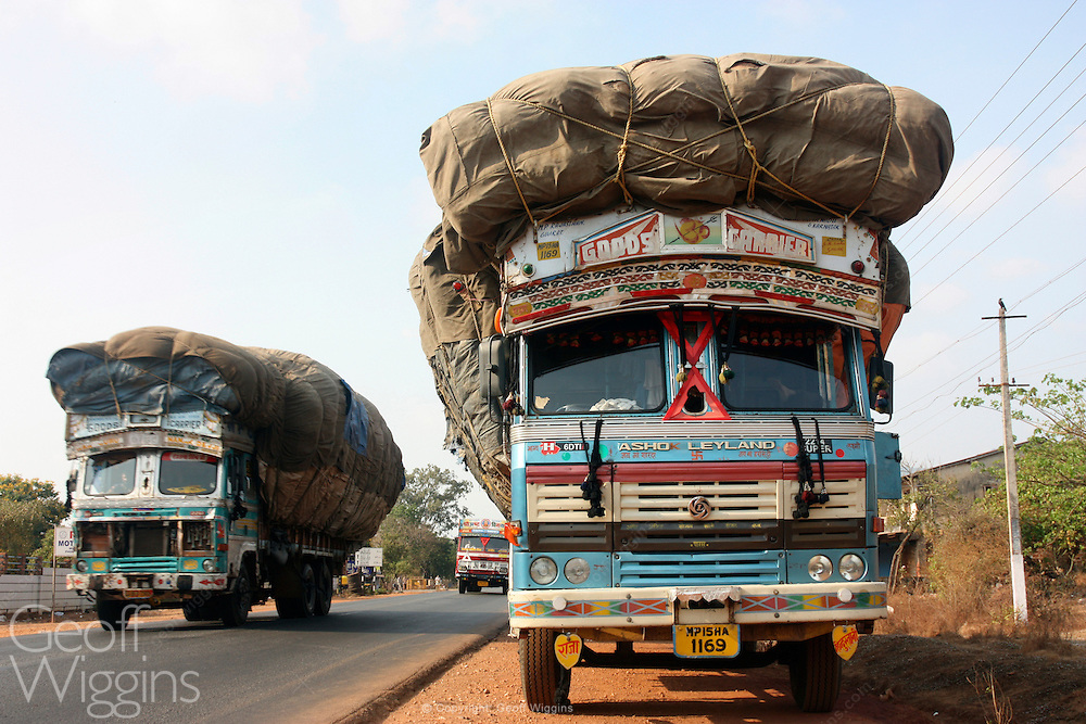 Overloaded Indian freight trucks carrying cargo of cotton on National Highway 17 Karnataka, India