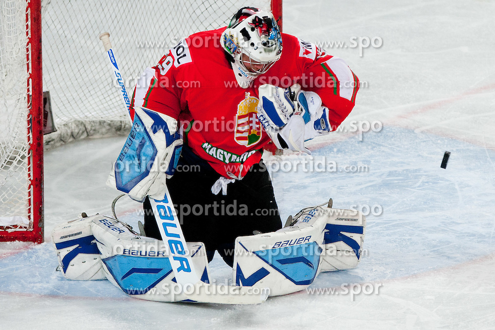 Goalie Bence Balizs of Hungary tries to catch a puck during ice-hockey match between Slovenia and Hungary at IIHF World Championship DIV. I Group A Slovenia 2012, on April 18, 2012 at SRC Stozice, Ljubljana, Slovenia. Slovenia defeated Hungary 4:1. (Photo By Matic Klansek Velej / Sportida.com)