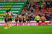 Hull City celebrate after Hull City midfielder James Weir (17) scores the winner during the EFL Cup match between Stoke City and Hull City at the Britannia Stadium, Stoke-on-Trent, England on 21 September 2016. Photo by John Marfleet.
